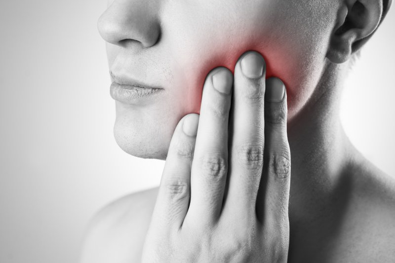 A woman in need of TMJ therapy in Century City.
