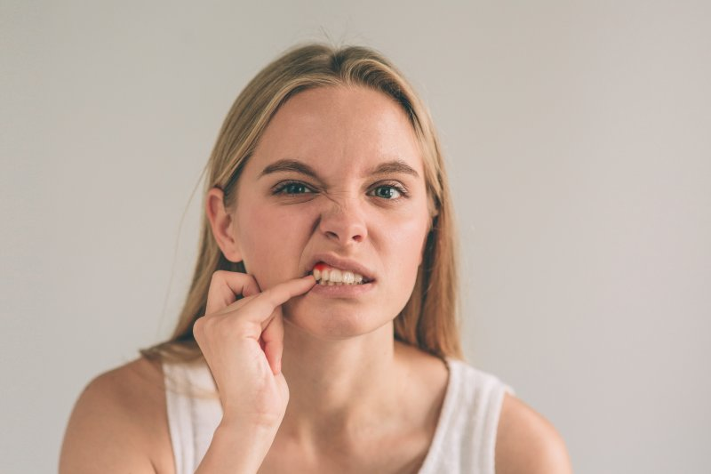 A woman considering veneers or gum recontouring for her smile.
